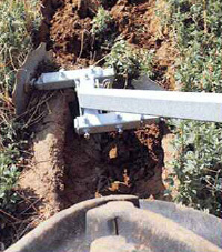 two angled disc wheels cut the soil